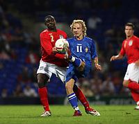 Photo: Chris Ratcliffe.<br /> England U21 v Moldova U21. European Championship Qualifier. 15/08/2006.<br /> Micah Richards of England U21 clashes with Alexandr Suvorov of Moldova U21.