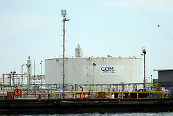 26 May 2010. Barataria Bay to Grand Isle, Jefferson/Lafourche Parish, Louisiana. <br /> Grand Isle.  Waterworld of the south, perched at the mouth of mississippi delta, all that seperates land from the Gulf of Mexico. Strategically vital to the American oil and gas industry and a major player in America's seafood industry. BP's catastrophic oil spill continues to spew a black tide of death which continues to encroach upon everything in the region. The economic impact is devastating with shrimp boats tied up, vacation rentals and charter boat fishing trips are cancelled. The only real business is cleaning up big oil's disasterous screw up. Oil from the Deepwater Horizon catastrophe is evading booms laid out to stop it thanks in part to the dispersants which means the oil travels at every depth of the Gulf and washes ashore wherever the current carries it. <br /> Photo credit; Charlie Varley<br /> www.varleypix.com