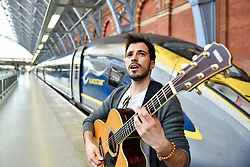 © Licensed to London News Pictures. 14/06/2017. London, UK. Luca Fiore, winner of the Eurostar prize at last year's Gigs event, a competition supported by the Mayor of London, sets off from St Pancras on a whirlwind busking tour of Paris.  He will showcase London's internationally renowned busking talent across some of the French capital's most iconic locations.   Photo credit : Stephen Chung/LNP