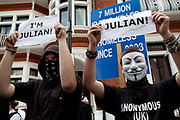 "London, UK. Thursday 16th August 2012. Supporters of Julian Assange from Anonymous UK wearing masks outside the Ecuador Embassy. These protesters were peaceful and were holding up signs saying ""I'm Julian""."