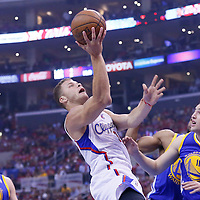 21 April 2014: Los Angeles Clippers forward Blake Griffin (32) goes for the layup over Golden State Warriors guard Klay Thompson (11) during the Los Angeles Clippers 138-98 victory over the Golden State Warriors, during Game Two of the Western Conference Quarterfinals of the NBA Playoffs, at the Staples Center, Los Angeles, California, USA.