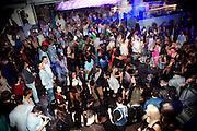 """Reportage about Angolans in Lisbon, Portugal.<br /> Angolan youth crowd having fun on a saturday night in """"Docks Club"""" disco in downtown Lisbon.<br /> Bruno Simões Castanheira / 4 SEE"""