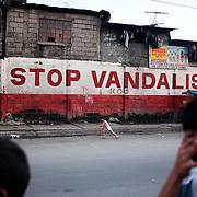 A street scene in the Parola district of Tondo, one of the worst slum areas of Manila on October 8, 2008 in Manila, the Philippines. Photo Tim Clayton