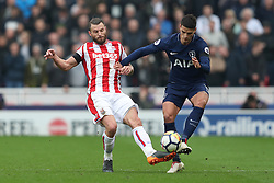 Stoke City's Erik Pieters (left) and Tottenham Hotspur's Fernando Llorente battle for the ball
