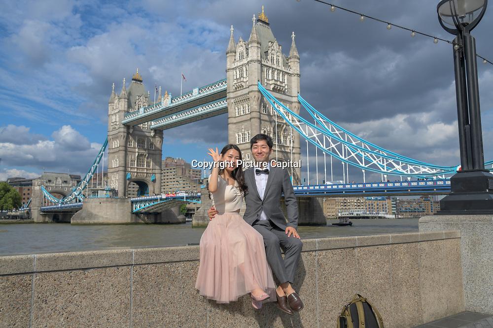 Oriental couple per-wedding shoot at Tower bridge on 18 July 2019, City of London, UK.