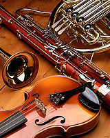 Woodwind, Brass and String instruments on a wood background