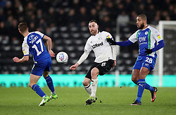 Derby County's Richard Keogh (centre) in action with Wigan Athletic's Michael Jacobs (left) and Leon Clarke during the Sky Bet Championship match at Pride Park, Derby.