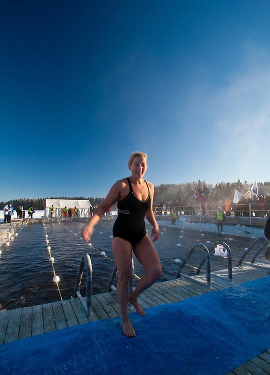 The happy competitor Aini Hämäläinen after her performance in  Finnish Ice Swimming Championships in Ellivuori, Finland.
