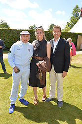 Left to right, SIR JACKIE STEWART, ANNE STEWART and MARK STEWART at the Cartier hosted Style et Lux at The Goodwood Festival of Speed at Goodwood House, West Sussex on 29th June 2014.