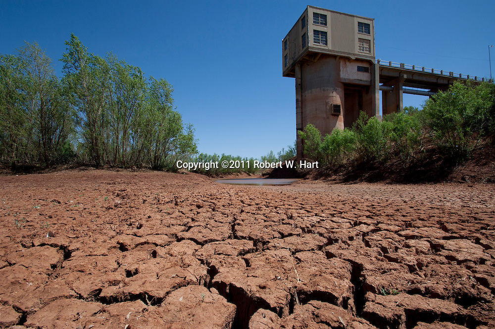 A pump house at Lake J.B. Thomas sits high and dry with almost no water remaining to pump. The lake level is at 4.60 percent.