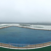Penzance's Jubilee Pool was opened in 1935 to mark the Silver Jubilee of George V.  Today, it is one of the few remaining 1930s lidos in the country.  In fact, measuring 100 x 73 metres on its longest axes, the Jubilee Pool is Britain's largest surviving seawater lido. <br /> <br /> Jutting out into Mount's Bay on the seafront in Penzance, the Jubilee Pool is one of Cornwall's most famous landmarks.  With its sweeping art deco curves and bright blue and white modernist lines, it's easy to believe it is perched on the edge of the Mediterranean!