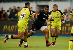 Saracens' Mako Vunipola is challengd by Leicester Tigers' Tom Youngs and Ellis Genge during the Aviva Premiership match at Allianz Park, London.