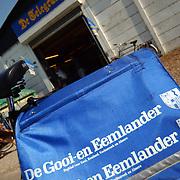 Krantentas aan fiets