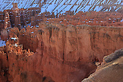 USA, Utah, Bryce Canyon National Park, hikers in a window in the rock at Sunset Point