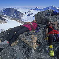MOUNTAINEERING. Alex Lowe & Greg Child sleep atop Great Sail peak after month-long big wall climb on north face of an arctic cliff.