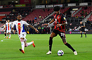 Philip Billing (29) of AFC Bournemouth is shadowed by Jordan Ayew (9) of Crystal Palace during the EFL Cup match between Bournemouth and Crystal Palace at the Vitality Stadium, Bournemouth, England on 15 September 2020.