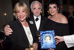 """File Photo - """"French actress Jeanne Moreau, French singer Charles Aznavour and Liza Minnelli attend a diner held at Carlton Hotel in Cannes after Gilles Jacob honored Liza Minnelli with the 'Festival de Cannes"""""""" award during the 58th International Cannes Film Festival, France on May 18, 2005. Actress Jeanne Moreau, one of French cinema's biggest stars of the last 60 years, has died at the age of 89. The star is probably best known for her role in Francois Truffaut's 1962 new wave film Jules et Jim. She won a number of awards including the best actress prize at Cannes for Seven Days... Seven Nights in 1960. She also worked with Orson Welles on several films and won the Bafta Award for best foreign actress for Viva Maria! in 1967. Photo by Benoit Pinguet/ABACA"""""""