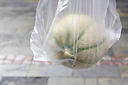 watermelon in clear plastic bag