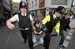 © Licensed to London News Pictures. 02/04/2012.  Police remove a protestor at a protest against unmanned aerial vehicles or drones used for military operations in Afghanistan and elsewhere and for surveillance in the UK.  The protest was outside a conference on UAVs at Armada House in Telephone Avenue in central Bristol.  Police made several arrests but its not known if this protestor was arrested...Photo credit : Simon Chapman/LNP