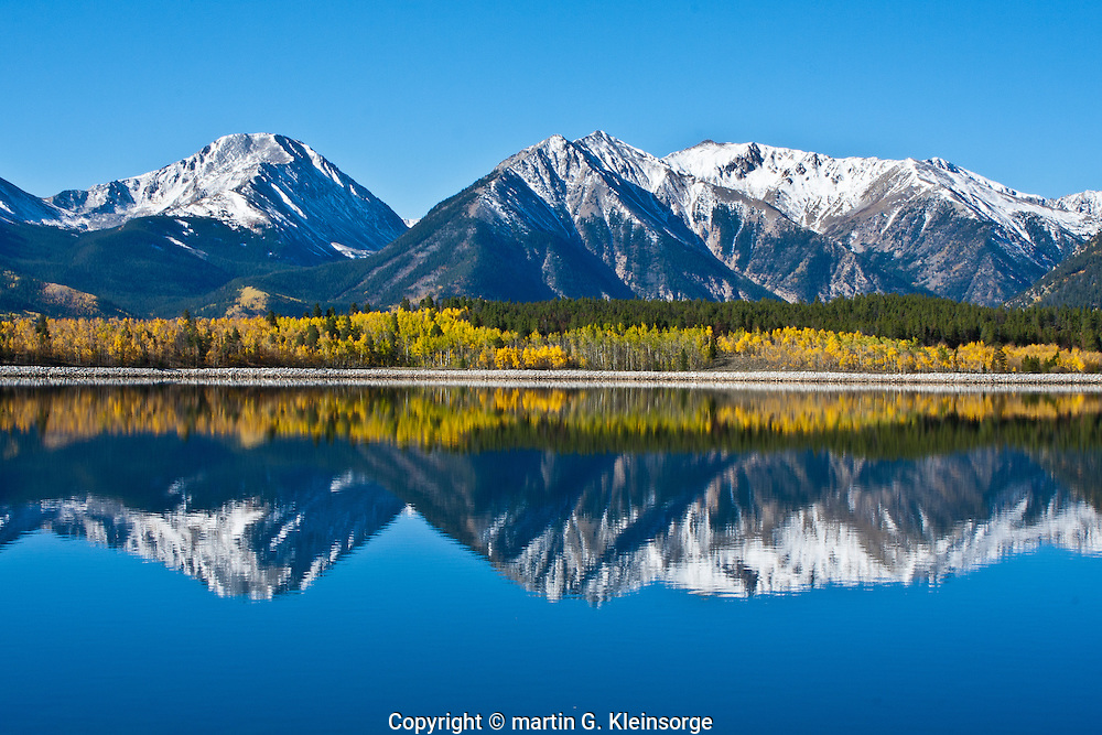 Reflections of 13,333 ft. Twin Peaks (center), with Mount Hope (left) and 13,783 ft. Rinker Peak  (right) in Mount Elbert Forebay.  Sawatch Range, Colorado.