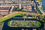 Nederland, Zuid-Holland, Schoonhoven, 28-10-2014; stadsgezicht met  in de voorgrond de ijsbaan annex volkstuinen en de watertoren.<br /> luchtfoto (toeslag op standard tarieven); aerial photo (additional fee required); <br /> copyright foto/photo Siebe Swart
