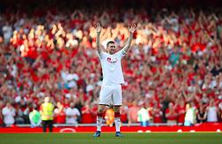 Arsenal's Per Mertesacker salutes the fans wearing a merci arsene t-shirt