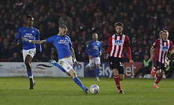 Marcus Maddison of Peterborough United shoots at goal against Lincoln City - Mandatory by-line: Joe Dent/JMP - 01/01/2020 - FOOTBALL - Sincil Bank Stadium - Lincoln, England - Lincoln City v Peterborough United - Sky Bet League One