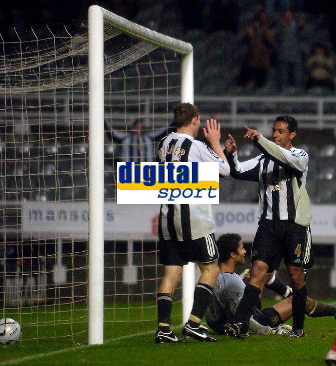 Photo: Jed Wee.<br /> Newcastle United v Portsmouth. Carling Cup. 25/10/2006.<br /> <br /> Newcastle's Nolberto Solano (R) celebrates after his second goal, acknowledging the role of James Milner's powerful run in the build up.