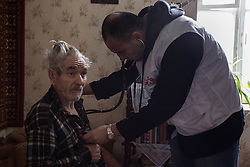 Doctor Kachatur Malakyan achecks on Nikolai, 77,Shevchuck in his home in Debalseve. Nikola suffers from chronic cardia disease and is bed-ridden. He relies on his wife to take care of him. MSF provides vital home care to patients like Nikolai who are house-bound and have stopped receiving medical care in the embattled eastern Ukranian town..