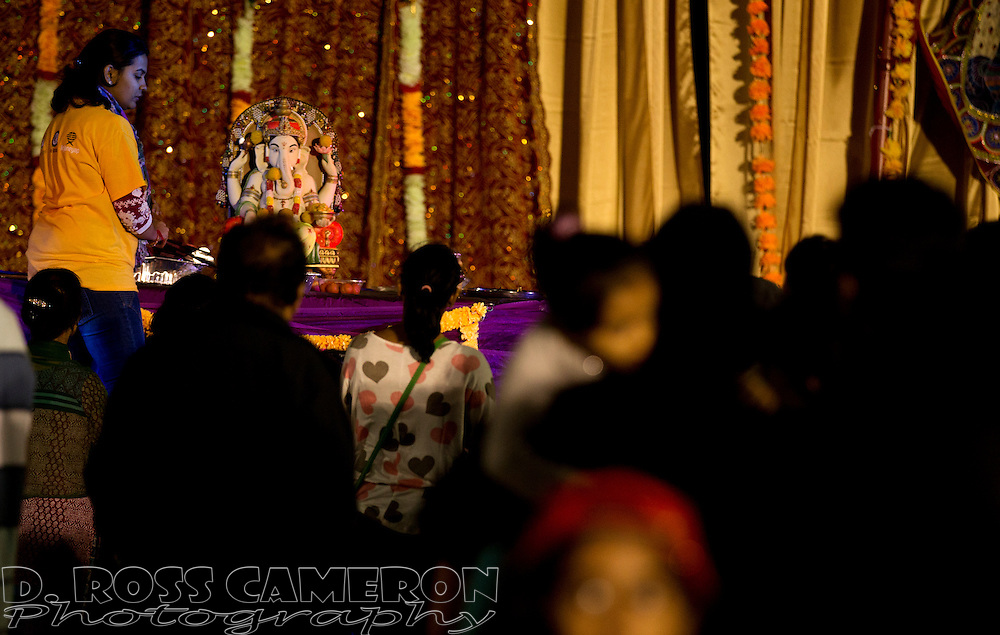 Hundreds of people line up to pay their respects to Ganesha at the first night of the Ganesh Utsav festival at the NewPark Mall in Newark, Calif., Thursday, Sept. 17, 2015. The popular Indian festival to honor Ganesha, one of the best-known and most worshipped deities in the Hindu pantheon, continues through Sunday. (Photo by D. Ross Cameron)