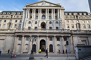 People walk in front of the Bank of England in what would normally be the morning rush hour in the City of London on March 17th, 2020. The financial district of the UK is unusually quiet after the government requested people to refrain from all but essential travel and activities yesterday.