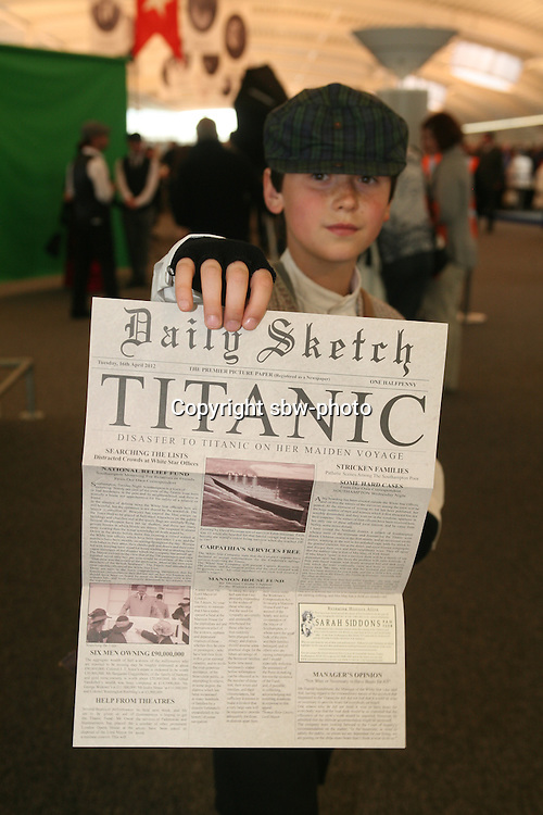 Miles Morgan Travel's Titanic Memorial Cruise leaves Southampton..Exactly1309 paying passengers from all over the world set sail from Southampton on a 12 night cruise to commemorate the centenary of the sinking of the Titanic..Child handing out memorial newspaper in the departure lounge.