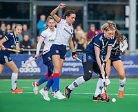 AMSTELVEEN -  Ginella Zerbo (SCHC) met Frederique Malefason (Pinoke) tijdens de competitie hoofdklasse hockeywedstrijd dames, Pinoke-SCHC (1-8) . COPYRIGHT KOEN SUYK
