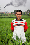 Portrait of Yusuf Supriyadi, local farmer.  Factories illegally dump toxic wastes into the Citarum River contaminating the water supply and directly impacting his rice paddies.  As a result, his rice has much lower quality and he has to sell them for half the normal price. Ciwalengke Village, Kabupaten Majalaya...Credit: Andri Tambunan for Greenpeace