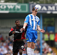 Photo: Chris Ratcliffe.<br />Colchester United v Queens Park Rangers. Coca Cola Championship. 16/09/2006.<br />Ray Jones (L) of QPR clashes with Greg Halford of Colchester United.