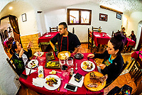 Chef Mario Perez sits down to talk about food with guests at his restaurant, La Tinaja, Guadix, Granada Province, Andalusia, Spain.