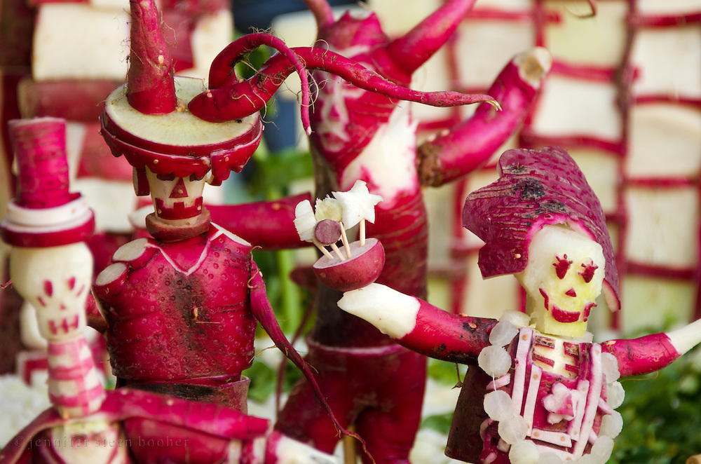 Two holidays combine: radishes are carved into figures celebrating Dia de los Muertos for a tableau at Oaxaca's Noche de Rabanos