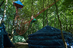 Tree platforms, a yurt, tepee and other dwellings in woodland at the Stop HS2 Wendover Active Resistance Camp are seen on 17th July 2020 in Wendover, United Kingdom. Environmental activists from groups including Stop HS2 and HS2 Rebellion continue to protest against HS2, which is currently projected to cost £106bn and which will remain a net contributor to CO2 emissions during its projected 120-year lifespan, on environmental and economic grounds.