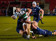 Newcastle Falcons wing Ben Stevenson breaks past Sale Sharks flanker Sam Dugdale and hooker Curtis Langdon during a Gallagher Premiership Round 12 Rugby Union match, Friday, Mar 05, 2021, in Eccles, United Kingdom. (Steve Flynn/Image of Sport)