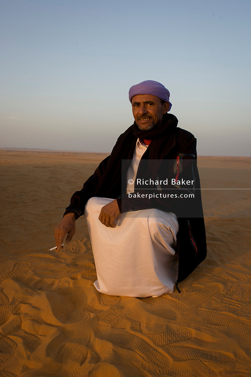 A Bedouin in desert sand dunes at al-Galamun, near Dahkla Oasis, Western Desert, Egypt. The past few decades have been difficult for traditional Bedouin culture due to changing surroundings and the establishment of new resort towns on the Red Sea coast, such as Sharm el-Sheikh. Bedouins in Egypt are facing a number of challenges: erosion of traditional values, unemployment, and various land issues. The Western Desert covers an area of some 700,000 km2, thereby accounting for around two-thirds of Egypt's total land area. Dakhla Oasis is one of the seven oases of Egypt's Western Desert (part of the Libyan Desert). It lies in the New Valley Governorate, 350 km (220 mi.) and measures approximately 80 km (50 mi) from east to west and 25 km (16 mi) from north to south.