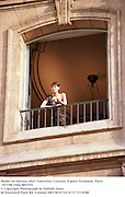 Model on balcony after Valentino. Couture. 8 place Vendome, Paris. 19/7/98. Film 98557f3<br />© Copyright Photograph by Dafydd Jones<br />66 Stockwell Park Rd. London SW9 0DA<br />Tel 0171 733 0108
