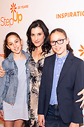 Kaye Popofsky Kramer, Founder of Step Up Wome's Network, (center) with daughters