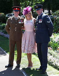 Nicki Chapman poses for a photograph with members of the armed forces during day four of Royal Ascot at Ascot Racecourse.