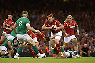 Dan Baker of Wales charges at opposite number Ireland's Jamie Heaslip (8). .Wales v Ireland rugby union international, RWC warm up friendly match at the Millennium Stadium in Cardiff, South Wales on Saturday 8th August  2015.<br /> pic by Andrew Orchard, Andrew Orchard sports photography.