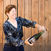 Winemaker Sabrine Rodems opens a bottle of Scratch sparkling wine at her winery in Soledad, Calif.