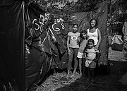 Jane Olincia, 45, lives in a small skack on Copa do Povo (People's Cup) camp with her three granddaughters: Evelyn 10, Laire, 9 and Jasmin, 4. The weather conditions during winter are quite difficult, high humidity and very cold nights, which worries Jane Olincia that one of the children can get pneumonia and she can't afford a doctor. Also she need to work and is hard for her to leave the children during all day by themselves. The Copa do Povo Camp, is just a few miles from the Arena Corinthians and has 5,000 homeless workers and their families occupied area of fifteen acres. They are homeless after rents skyrocketed because of the World Cup. (Eduardo Leal).