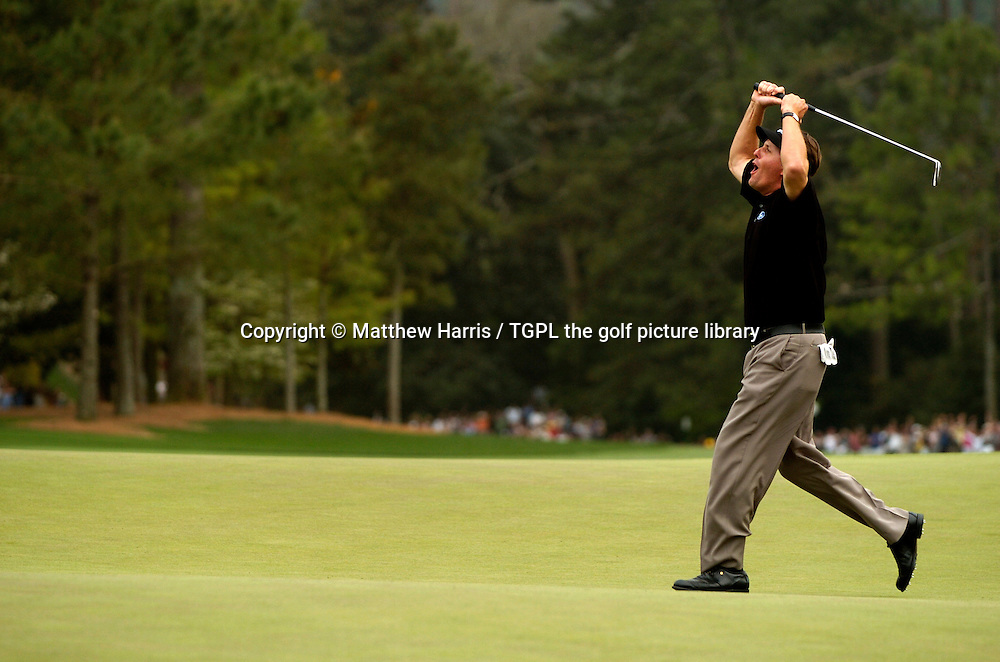 Phil MICKLESON (USA) celebrates making birdie at the 18th par 4 for victory and his first major and a famous green jacket during fourth round US Masters 2004,Augusta National, Augusta, Georgia, USA.
