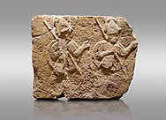 Picture & image of Hittite relief sculpted orthostat stone panel of Long Wall Limestone, Karkamıs, (Kargamıs), Carchemish (Karkemish), 900-700 B.C. . Anatolian Civilisations Museum, Ankara, Turkey.<br /> <br /> Two helmeted soldiers in short skirt carry shield on their backs and spear in their hands.<br /> <br /> On a gray background. .<br />  <br /> If you prefer to buy from our ALAMY STOCK LIBRARY page at https://www.alamy.com/portfolio/paul-williams-funkystock/hittite-art-antiquities.html  - Type  Karkamıs in LOWER SEARCH WITHIN GALLERY box. Refine search by adding background colour, place, museum etc.<br /> <br /> Visit our HITTITE PHOTO COLLECTIONS for more photos to download or buy as wall art prints https://funkystock.photoshelter.com/gallery-collection/The-Hittites-Art-Artefacts-Antiquities-Historic-Sites-Pictures-Images-of/C0000NUBSMhSc3Oo