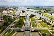 Nederland, Zeeland, Terneuzen, 09-05-2013; Sluizencomplex Terneuzen. Binnenvaartschepen verlaten de Oostsluis of binnenvaartsluis. Bedrijventerrein en Terneuzen links.<br /> View on the sluices of Terneuzen. Barges leaving the  canal sluice (Oostsluis).<br /> luchtfoto (toeslag op standard tarieven)<br /> aerial photo (additional fee required)<br /> copyright foto/photo Siebe Swart