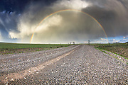 Rainbow over a Montana backroad near the Rocky Mountain Front.